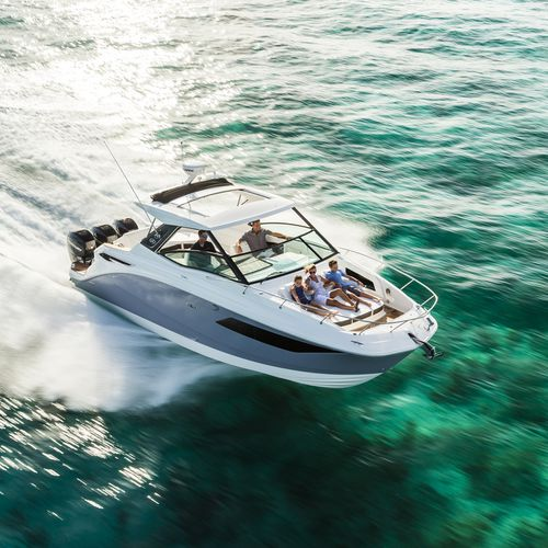 outboard express cruiser / triple-engine / soft-top / sport