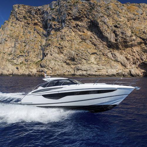 inboard express cruiser / diesel / twin-engine / soft-top