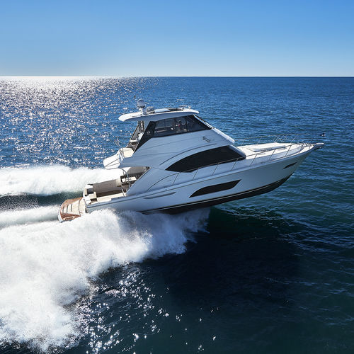 cruising motor yacht / with enclosed flybridge / IPS / planing hull