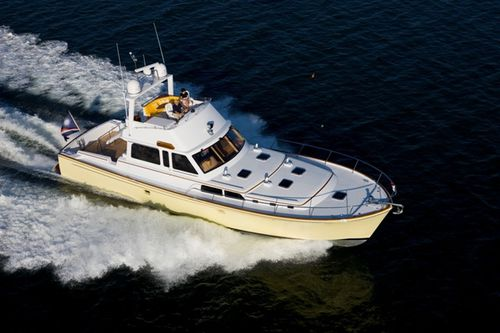 cruising motor yacht / flybridge / soft-top / with 2 or 3 cabins
