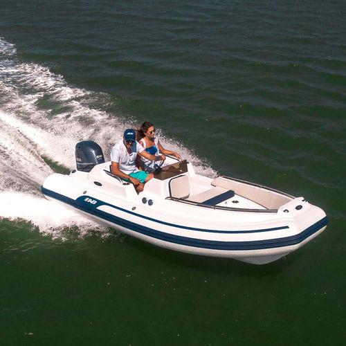 outboard inflatable boat / rigid / side console / fiberglass