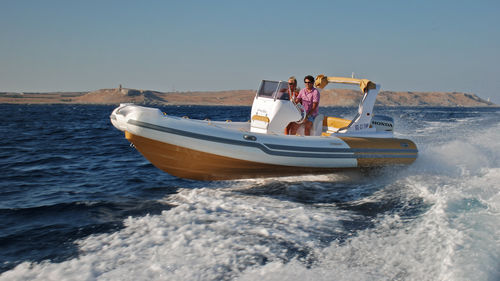outboard inflatable boat / rigid / center console / 12-person max.