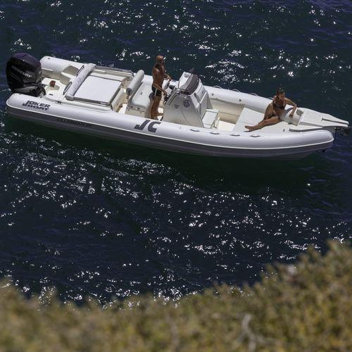 outboard inflatable boat / rigid / center console / 22-person max.