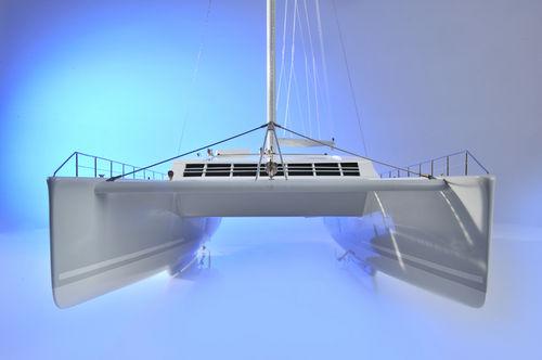 sailing catamaran / ocean cruising / open transom / center cockpit