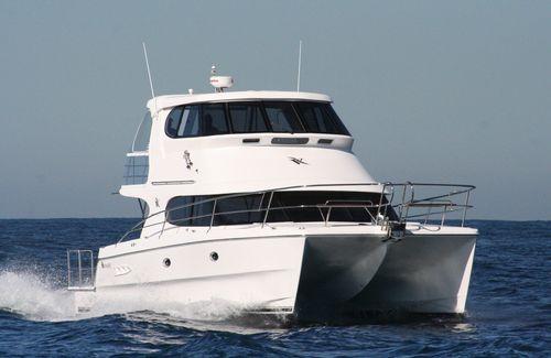 catamaran express cruiser / inboard / with enclosed flybridge / sport-fishing
