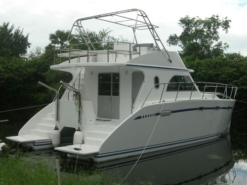 catamaran express cruiser / inboard / diesel / semi-custom