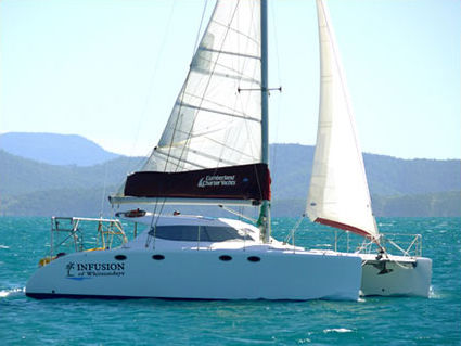 sailing catamaran / cruising / with enclosed cockpit / 4-cabin