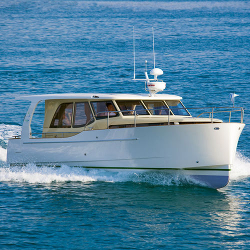 inboard express cruiser / hybrid / solar-electric powered / downeast