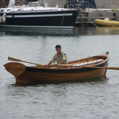 classic open sailboat / wooden