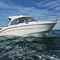 outboard cabin cruiser / wheelhouse / 9-person max. / sundeck