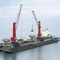 port crane / for heavy loads / floor track / luffing jib