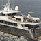 charter super-yacht / with enclosed flybridge / alloy / displacement