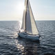 cruising sailboat / open transom / deck saloon / with 2 or 3 cabins