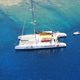 catamaran sailing yacht / charter / with open transom / with deck saloon