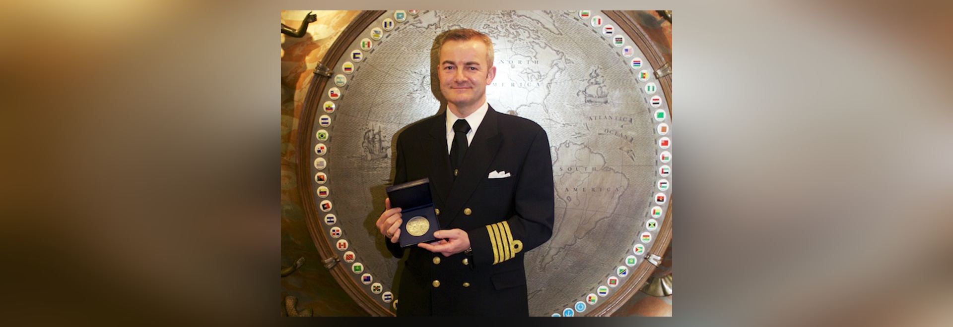 2014 IMO Award for Exceptional Bravery at Sea: Captain Andreas Kristensen with the medal he and his crew of the Britannia Seaways received.
