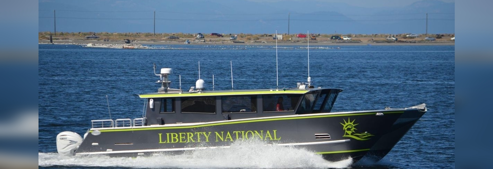 A bold vinyl wrap and Lumishore color changing underwater lighting give water taxi a striking appearance on the water.