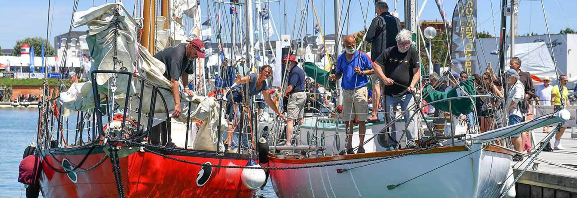 The crew of Bernard Moitessier's famous yacht JOSHUA tie up alongside Sir Robin Knox-Johnston's yacht SUHAILI in Les Sables d'Olonne for only the second time in history since both boats competed ag...