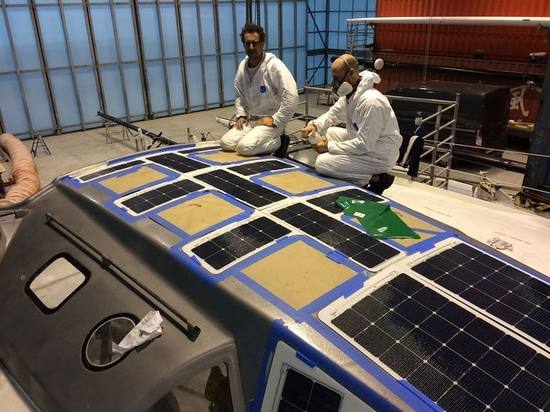 Panel installation using pre-mounted adhesive and UV-resistant edge sealant