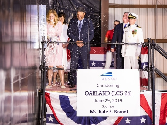 Dignitaries, guests, officials and other community members celebrate at the christening ceremony of the USS Oakland littoral combat ship built by Austal USA. Austal USA photo