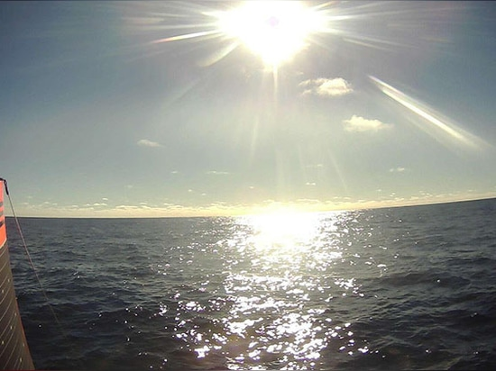SD 1020 sailing toward the sunrise on a rare calm day in the Southern Ocean.