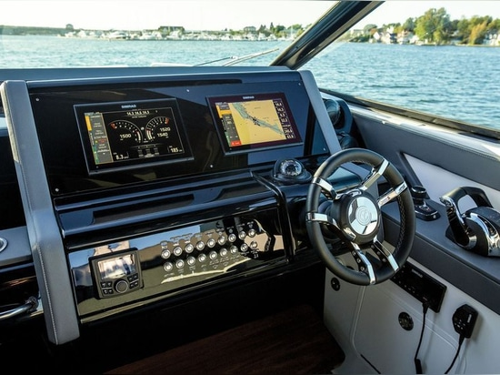 The nonreflective dash is inlaid with two rows of ­recessed push buttons for various systems.