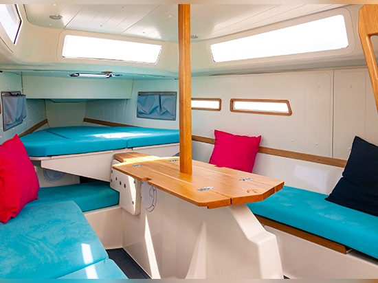 The folding solid-wood oak table sits on top of the lifting keel housing.