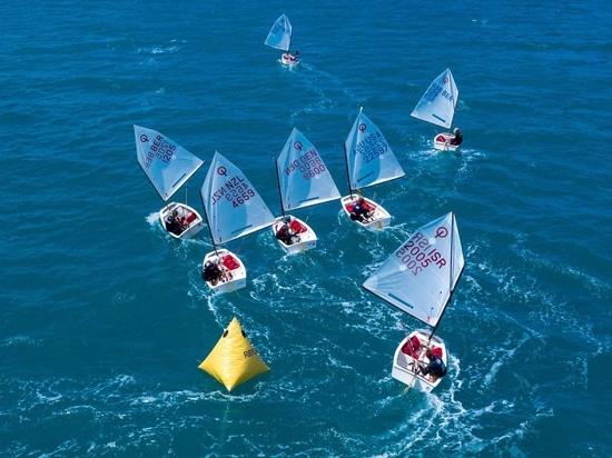Optis sailing downwind - RenaissanceRe Junior Gold Cup