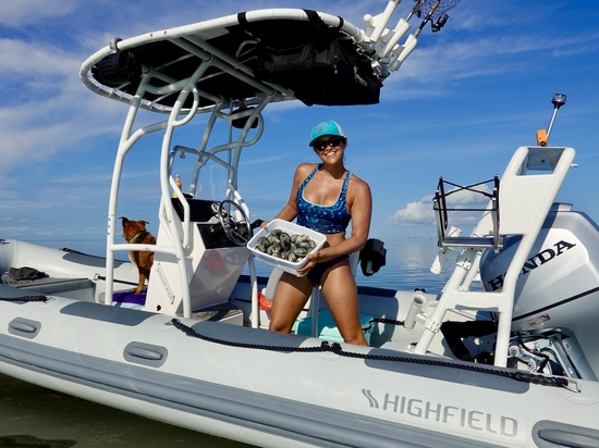 Sierra shows off the fruits of a clamming expedition on the new Highfield RIB.