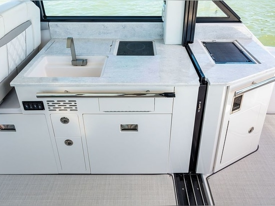 The Grande Coupe presents a full galley with grill, sink and refrigerator.
