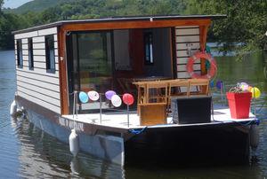 barco-casa catamarã