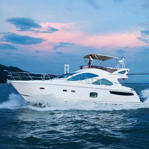 lancha Express Cruiser com motor de centro / com hard-top / com flybridge / rápida