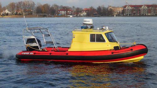 barco inflável com motor de popa / a diesel / semirrígido / com console jockey